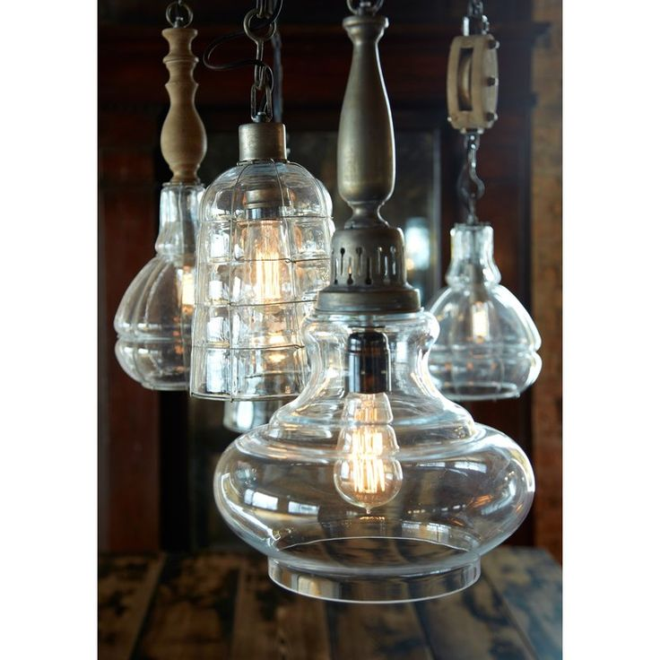 Curvy, wide glass shade paired perfectly with a vintage look spindle.