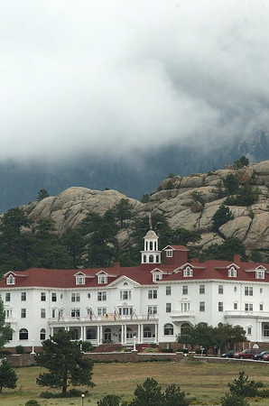 "The Stanley Hotel in Estes Park Colorado home of ""The Shining"" would so like to stay there but not in room 217!! Looks scary with the clouds hanging over it."