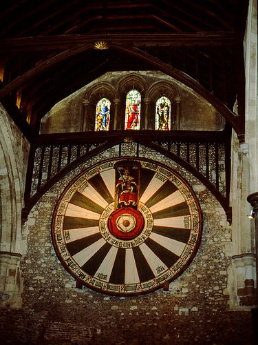According to legend, the Round Table which hangs in the Great Hall of Winchester Castle is the table around which King Arthur and his Knights met. 1290.  In the  years of King Henry VIII's reign the table was painted with the Tudor Rose