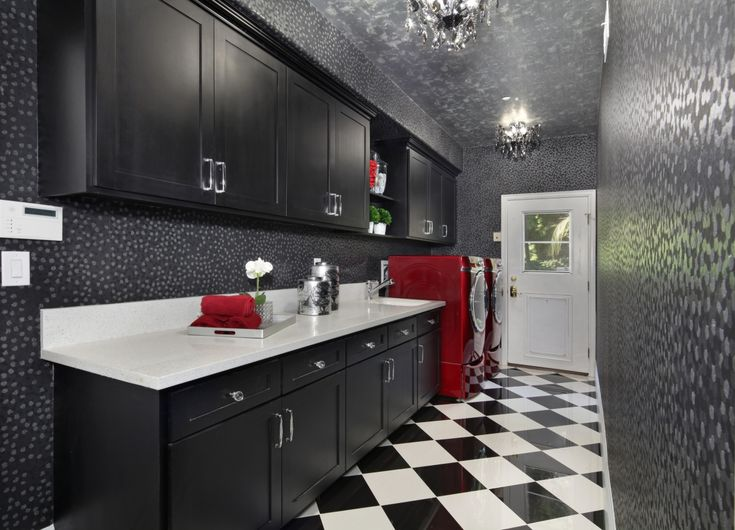 Red washer dryer and checkered floor. Laundry Room