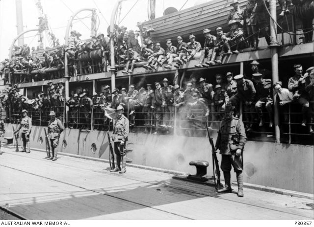 Troops on board HMAT Commonwealth (A73) prior to departure.  Four sentries remain on the wharf.Australia: Victoria, Melbourne, Port Melbourne 2 November 1917 Troops on board HMAT Commonwealth (A73) prior to departure. Four sentries remain on the wharf.