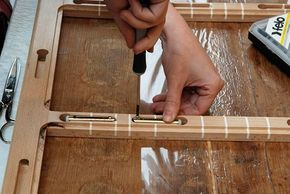 Attaching springs to a panel painting by Peter Paul Rubens