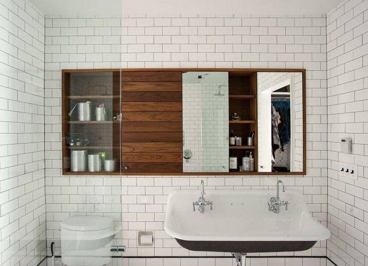 Bathroom in Cobble Hill duplex by architect Oliver Freundlich | Remodelista サブウェイタイル&はめ込みウッドキャビネット