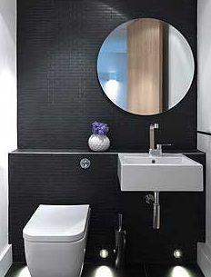 round mirror over narrower wall mount sink