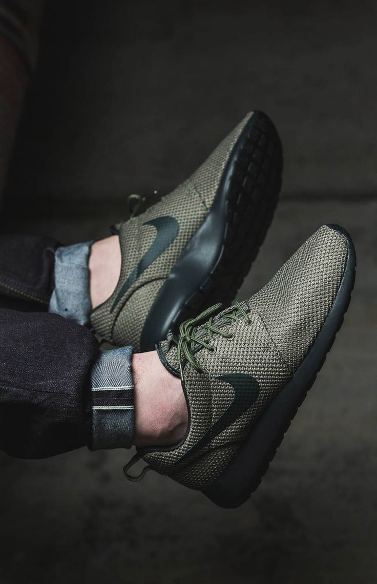 Black and olive green Roshe Runs paired with cuffed raw denim. -- Tags: sneakers, Nike