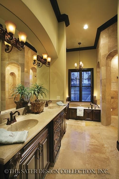 Sater design - Love the elegance of this bath!  Beautiful cabinetry contrast with travertine, light surfaces.  Not fond of lighting.