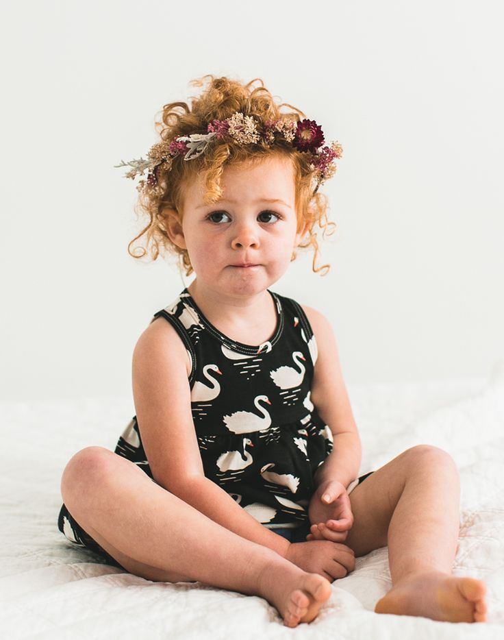 Baby girl with adorable curly red hair, wearing flower crown made from dried flowers by Sage Sisters for Noble Carriage. So simple sweet and cute boho baby. Flower child style just in time for spring.