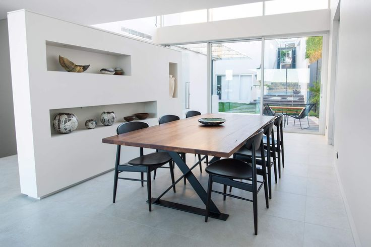 Modern Waterfront home in Sydney | Modern Home | Contemporary house | Sydney architecture | beach house | modern interior | white minimalist design | partition wall | glass sliding doors | designer table | designer chairs | dining room |