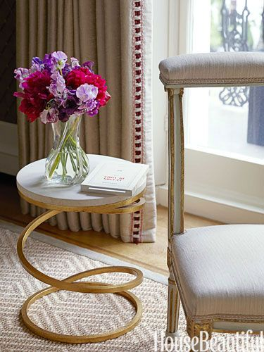 In a living room, a spiral-base table is both elegant and playful.