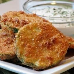 Get out your grater or food processor, you'll need to grate up a bunch of zucchini. But this is what makes these patties fry up so wonderfully. A nice change from potato pancakes. Serve with a bit of tomato sauce or sour cream dabbed on top.