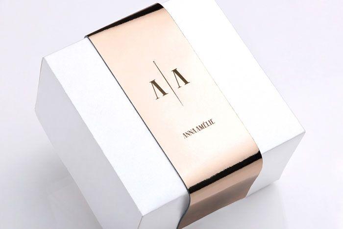 packaging: white box + gold + logo
