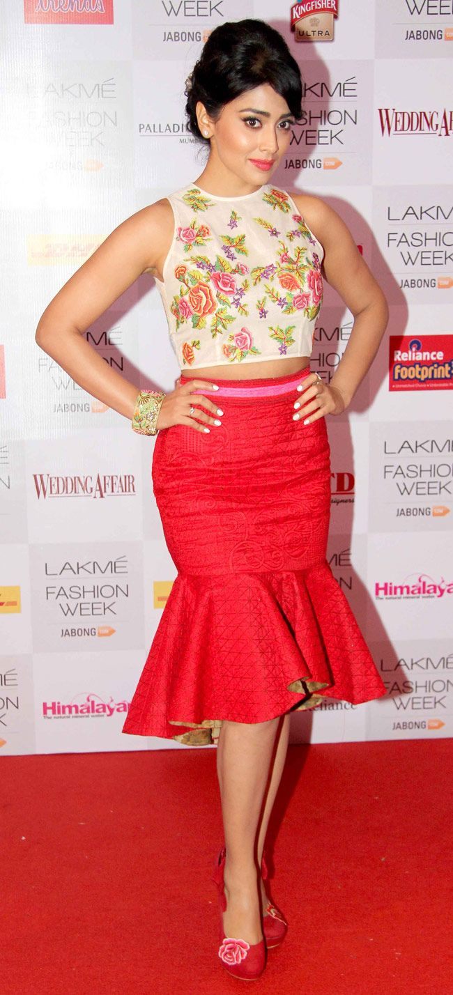 Shriya Saran arrived in a feminine floral number at the Lakme Fashion Week 2014 curtain raiser. ***