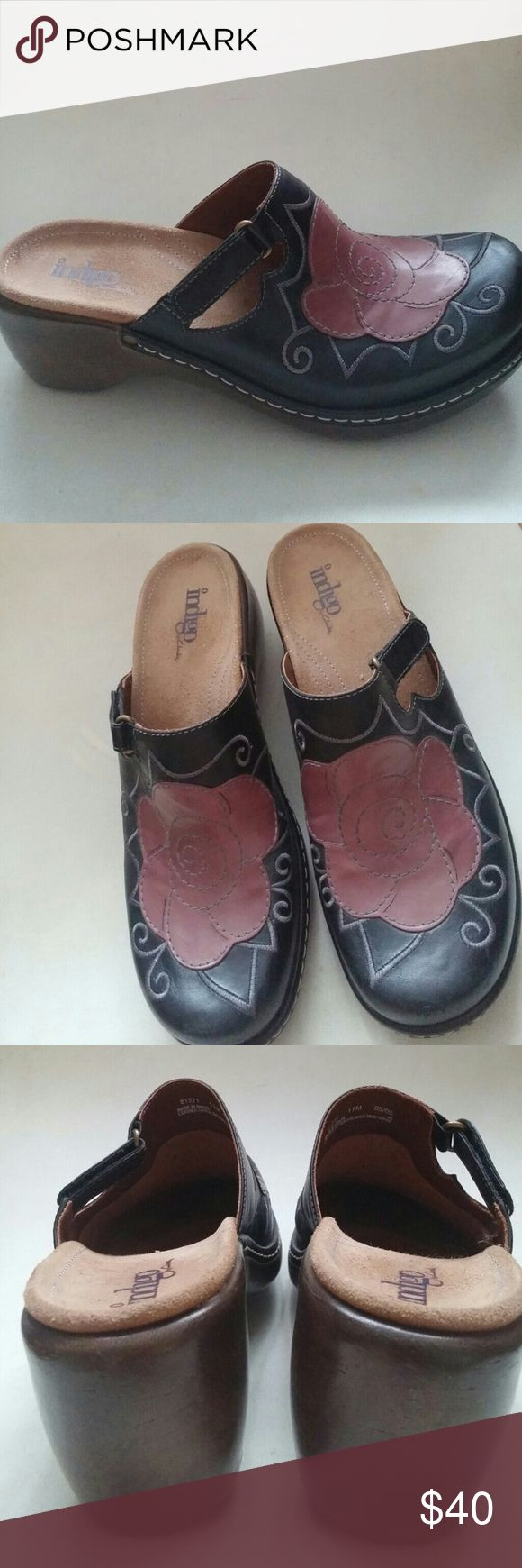 Size 11m (INDIGO) black clog floral shoes These are adjustable with a velcro strap to your comfort level.  They were also never worn but instead came out of a shoe store that closed I and maybe a few people tried them on with socks great deal for the right girl indigo Shoes Mules & Clogs
