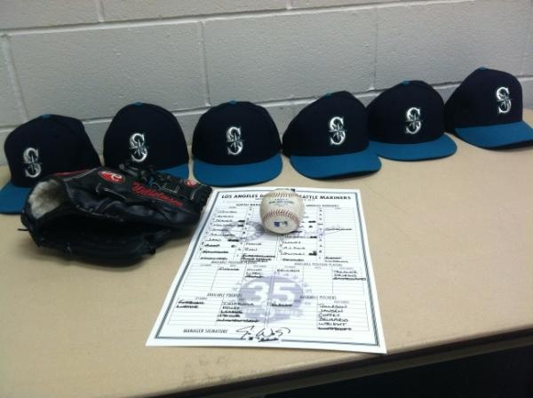 All six pitchers hats, the line-up card, Wilhelmsen's glove and the last out ball from tonight's game.Lineup Cards