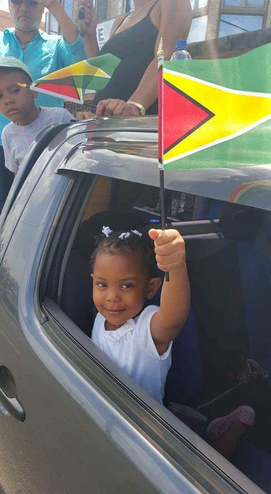 Guyanese children, Guyana flag