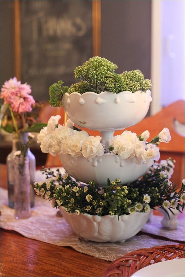 Love these stacked bowls filled with flowers - such a pretty centerpiece