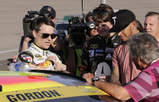 Last race: Jeff Gordon, left, prepares to get into his car before the NASCAR Sprint Cup Se...