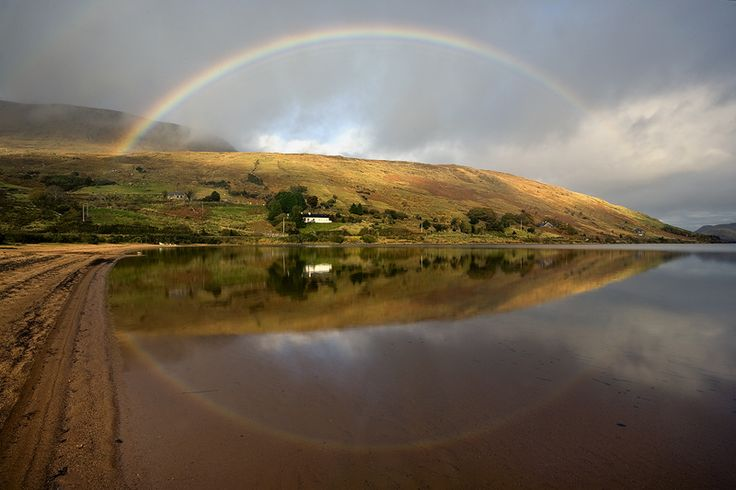 reflected rainbow lough nafooey connemara west of ireland. visit my web site www.lhandal.com