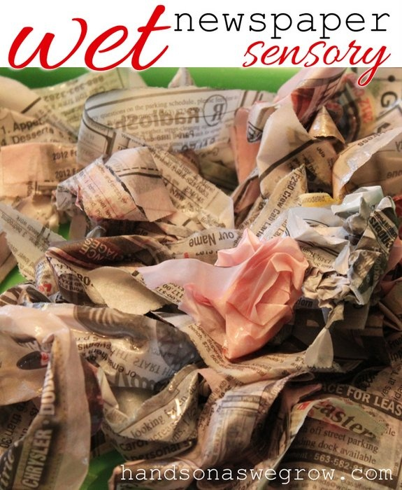 A water activity with newspaper. A soggy sensory activity for the kids.