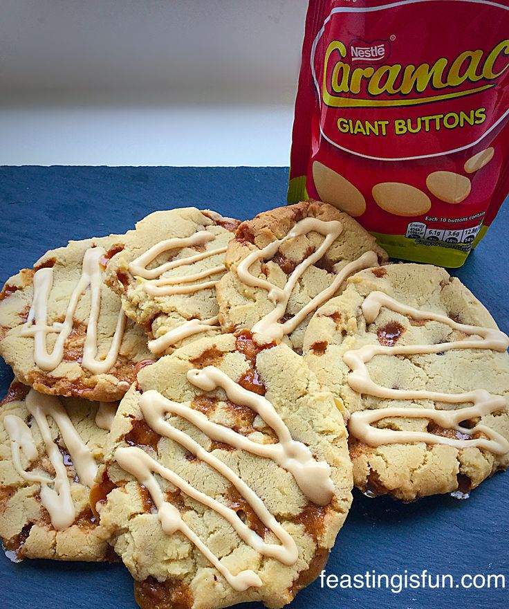 Caramac Caramel Cookies bursts of caramel melted through this chewy, light cookies, completed with a delightful Caramac drizzle on top. All the caramel flavours captured in a cookie. www.feastinisfun.com