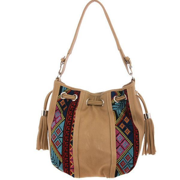 """- Embroidered aztec bucket bag - Approx. 13"""" length x 11"""" height x 6"""" deep - Magnet closure - Inside pockets - Man made materials - Imported - Ships within 3-5 business days"""