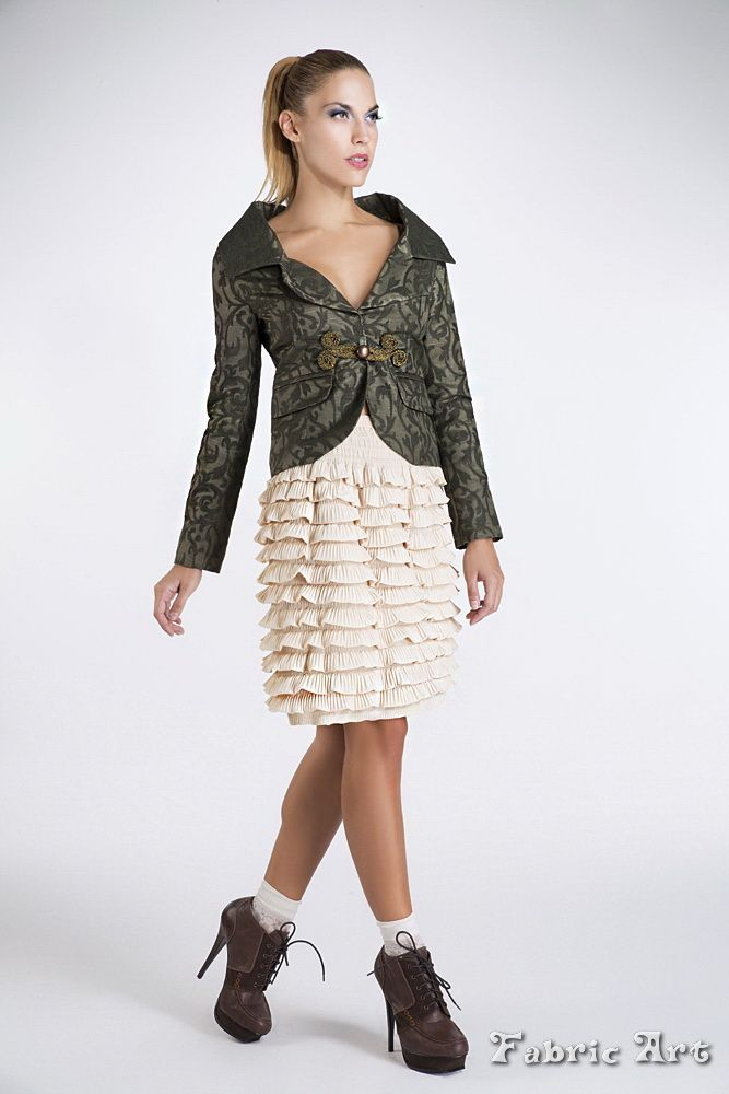 Wide collar brocade jacket. Skirt with 12 tiers and elastic waist band.