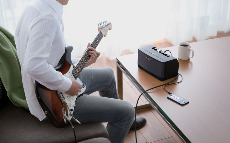 CUBE Lite (Black) Guitar Amplifier: Stylish guitar amp and music dock with iOS interface.