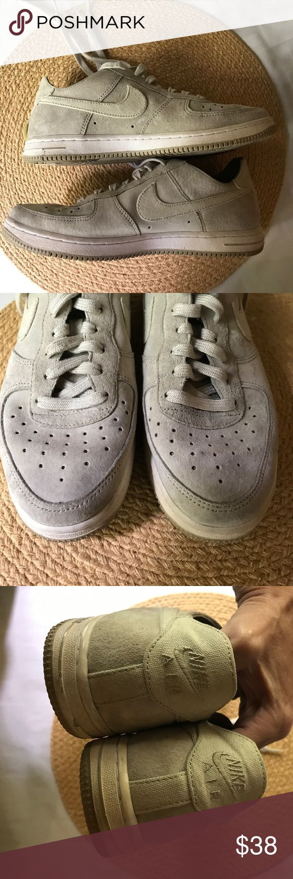 """Ladies size 7 Grey Nikes! Like new! Suede leather & canvas make for a killer shoe! They are in perfect condition, for they were only worn a few times. Please see pictures. There is a 1/2 """" section that the piping came off on the BACK of shoes- see pics! You wouldn't have even noticed it if I didn't mention it. Thanks for browsing! Nike Shoes Athletic Shoes"""