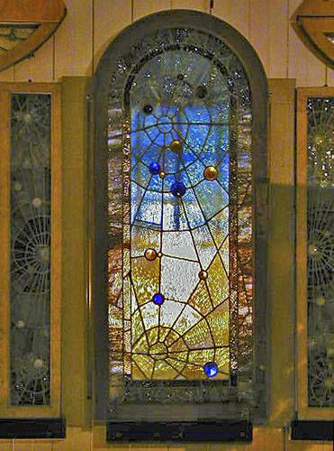 I am in love with these stained glass spiderweb windows from the Winchester house!