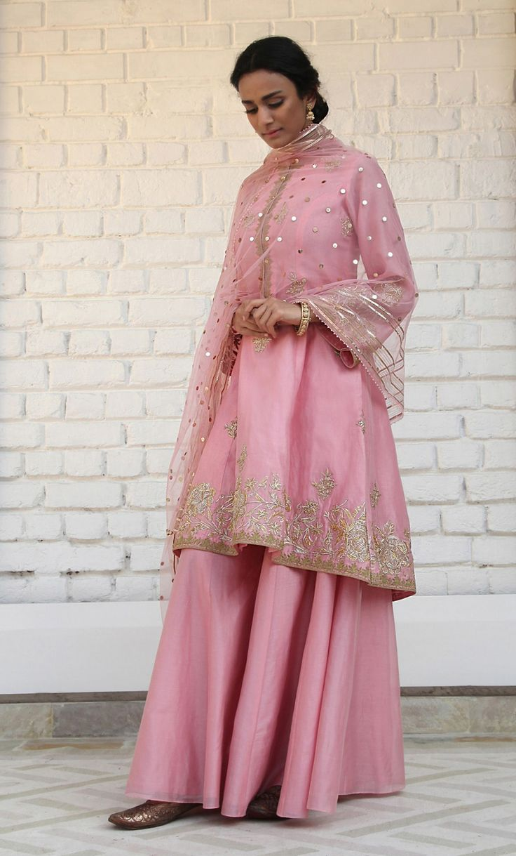 Blush Pink Chanderi silk A-line shirt featuring delicate gotta and tilla dori embroidery; paired with a soft tulle dupatta and silk sharara.