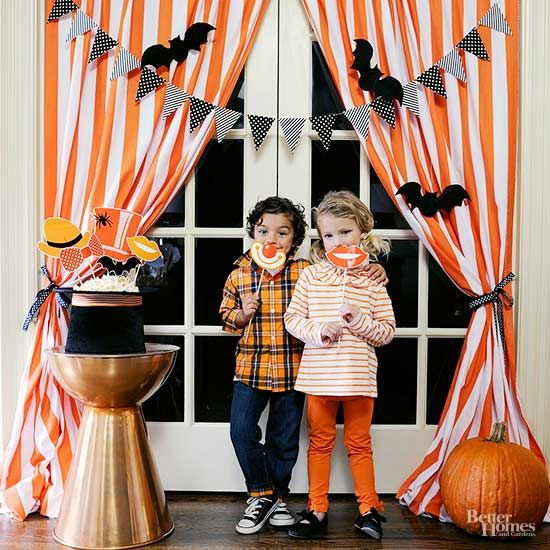Adding a DIY photo booth to your mini monsters' Halloween party ensures unforgettable party memories.