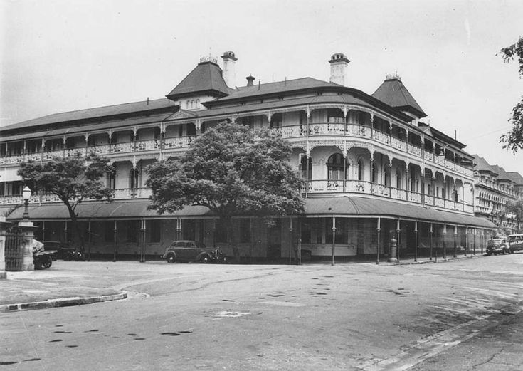 Bellevue Hotel, Corner of George and Alice Sts, 1940. Built in 1886 and was three storeys high with cast iron balustrades on the wrap around verandas, with posts supporting a curved corrugated iron roof. A steep pitched roof shows two mansard roofs with cast iron cresting and chimneys. Demolished April 1979 after midnight, under instructions from Premier Joh Bjelke-Petersen, by the Deen Brothers, with police protection. A crowd of over 700 protestors looked on in horror after failing to…