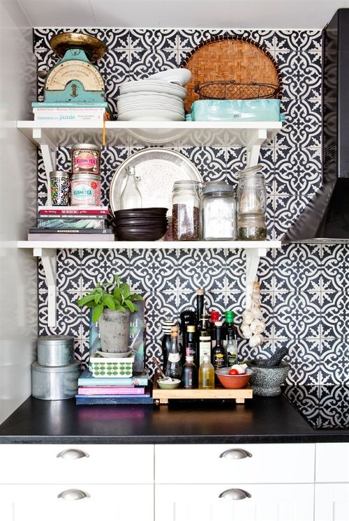 I love this Moroccan inspired splash back. It's got a lovely summer vibe about it. http://www.ceramictilewarehouse.co.uk/