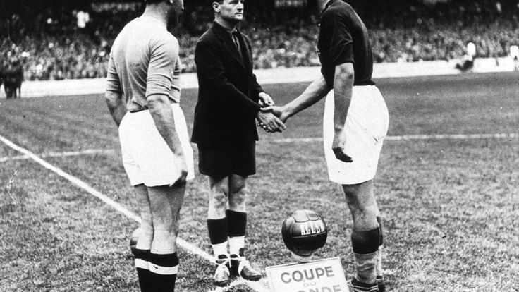 Final, Italia 4 v Hungary 2, 19th June, 1938. Italian captain Giuseppe Meazza (left) looks on as referee George Capdeville shakes hands with Hungarian captain Sarosi before the kick off