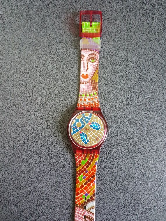 1990 Vintage Swatch Watch, Mosaiques collection. Ravenna.  Designed By Beatrice Santicciolli  Diameter case 33 mm.  Water-resistant 30 Meters / 100 Feet.    You are looking at a 1990 Swatch swiss watch. This model is called Ravenna. I acquired a large well taken care of collection of SWATCH watches and I am putting them all up on etsy.. This swatch is in excellent to mint condition. I do not believe it was worn. This is one abstract mosaique swatch watch. It is a beautiful model and pret...