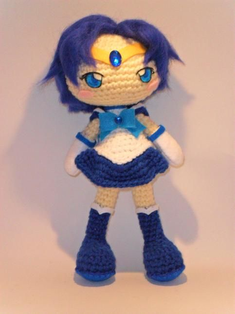 """Ami Mizuno as Sailor Mercury, soldier of water and wisdom. From the manga and anime Sailor Moon.  - This item is meant for display only. - 11"""" approximately. - Made of 100% acrylic yarn,  eco-friendly felt, polyester fiberfill stuffing. - The color may vary slightly from what is   shown."""