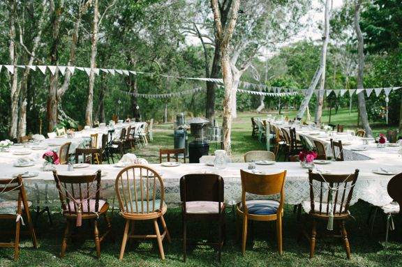 Mismatched chairs and eclectic table settings for this shabby chic outdoor wedding