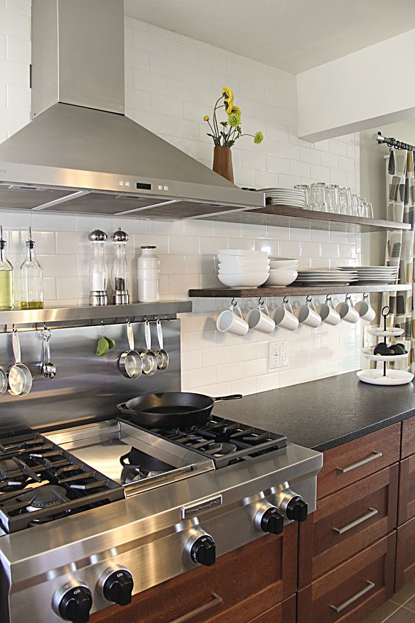 I am completely smitten with these open shelves and above-stove organizational items. via Montana Prairie Tales blog