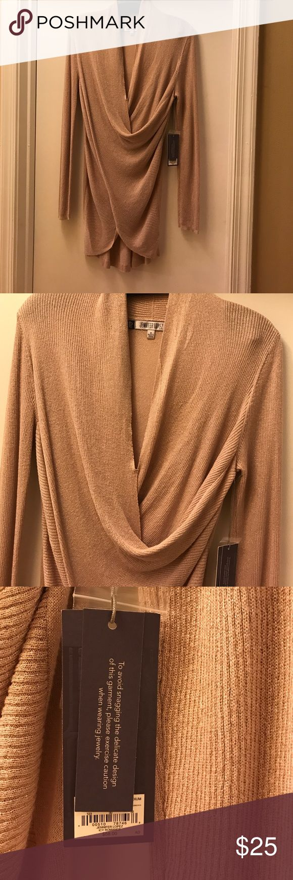 Jennifer Lopez brand new top Brand new too by Jennifer Looez. Gorgeous light pink with silver shimmer throughout. Nice swoop neck with perfect rouging in the front with three quarter sleeve. Soft comfortable material - cannot feel the shimmer not itchy. Jennifer Lopez Tops Blouses