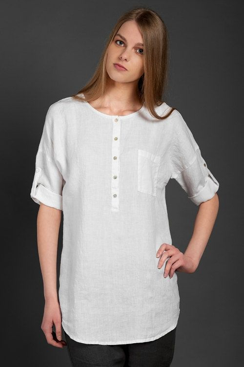 White 100% linen summer blouse with adjustable 3/4 sleeves and a front pocket on the left. It also features a row of buttons at the front, and a rounded neckline. The bottom of the blouse is also slightly rounded at both the back and the front. Made from thin, lightweight, specially washed fabric, therefore, soft and shrink-resistant. This loose-fitting blouse will make a nice addition to your summer wardrobe. // €75