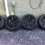 : Black truck rims and tires for sale