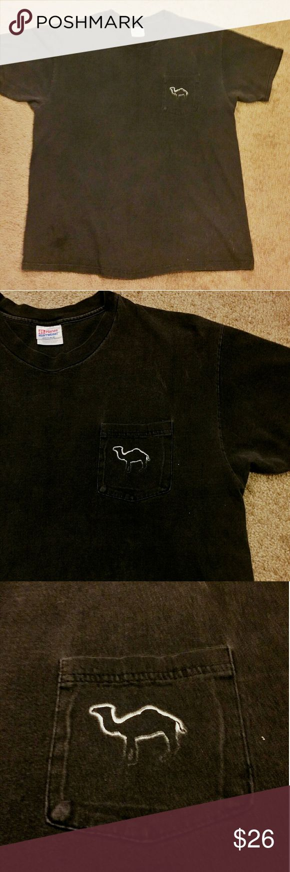 Vintage Men's Joe Camel Black Pocket Tee Description: Vintage Joe Camel Tee Shirt. Eclipse Version. Front small rightside pocket with Joe and reverse graphics featuring an eclipse over Joe the Camel.   This is a worn vintage item that was naturally distressed. Now has a tiny bleach dot on the back shoulder, as seen in photos, and a small stain that hardly noticable in front towards bottom left. Still less of life left~  Size: Adult XL Vintage Shirts Tees - Short Sleeve