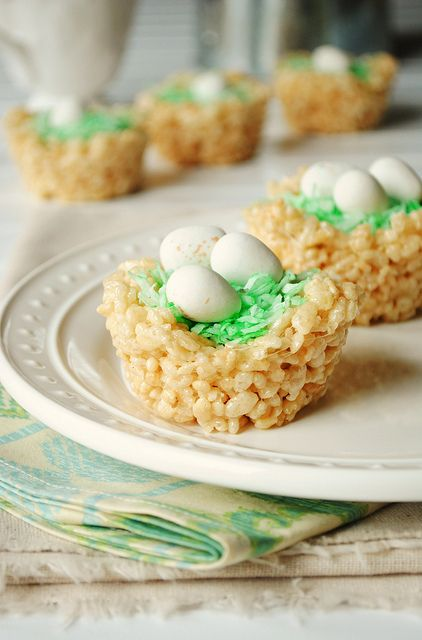 Easter Egg Nests Ingredients: 1/4 teaspoon water 2-4 drops of green food coloring 1/2 cup flaked coconut 1 package (10 ounces) regular marshmallows 6 cups Rice Krispies 1 bag Cadbury chocolate eggs
