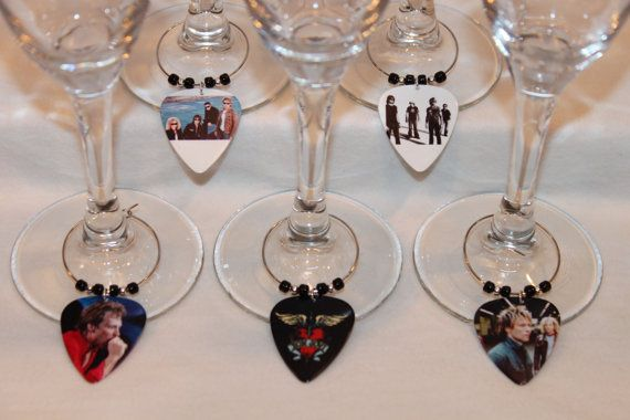 BAW Creations Custom Made Bling for Your Wine Glass! This is a set of 5 custom made Bon Jovi Themed Wine Glass Markers. With these Wine Glass Markers, you will never lose your drink at a get together. Perfect for a Girls Night! Great unique gift idea! Use them as Party Favors! They are made from actual plastic Guitar Picks! Not Dishwasher safe. Not for children under 5. PAYPAL only please. Please feel free to contact me with any questions or special requests. Thank You! **Check out my ot...