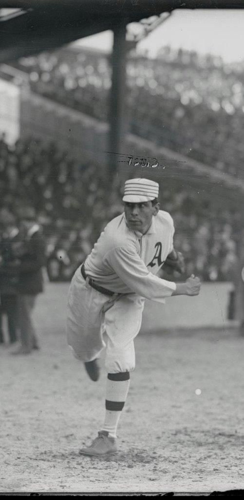 October 17, 1910, at Shibe Park: Philadelphia Athletics Hall of Fame pitcher Chief Bender warms up prior to starting Game 1 of the World Series against the Chicago Cubs.  Bender would dominate, winning 4-1, allowing only an unearned run in the 9th inning with a final line of 9 IP, 3 hits, 8 strike outs.