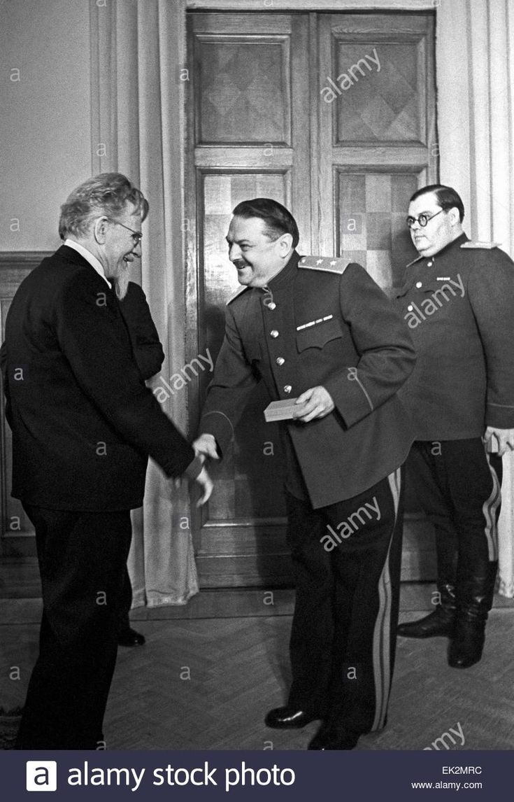 Moscow. Mikhail Kalinin L presented Andrei Zhdanov with the Order of Alexander Suvorov of the first grade in the Kremlin. Colonel General A. Shcherbakov R. Stock Photo