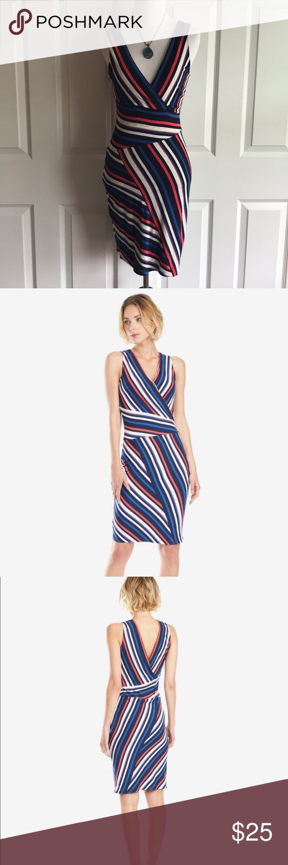 "‼️NEW ITEM‼️ Matty M Striped Bodycon Dress NWT Matty M. Bodycon dress with plunging neck and back. Sleeveless. Mixed stripe fabric in navy, royal blue, oatmeal, and red. Materials: 92% rayon / 8% spandex—soft like tee shirt material. Measurements: bust is 14"", waist is 12.5"", and total length is 35"". NWT. Bought from a PFF but way too small. Matty M Dresses Midi"
