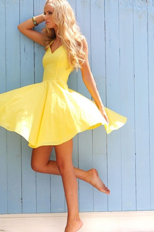 this is completely me. long, messy hair, yellow sundress, & barefeet…