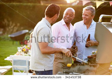 Mature Male Friends Enjoying Outdoor Summer Barbeque - stock photo