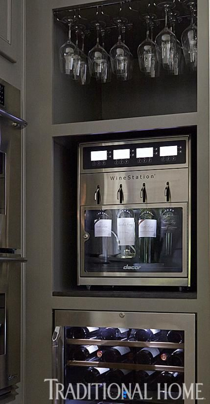 Well, if this isn't the greatest thing ever! The stainless steel, temperature-controlled Discovery WineStation can hold and dispense up to four regular or magnum sized bottles of wine and preserve them for up to 60 days. - Traditional Home ® / Photo: John Merkl / Design:  Christine Teicheira and Lauren Tapper